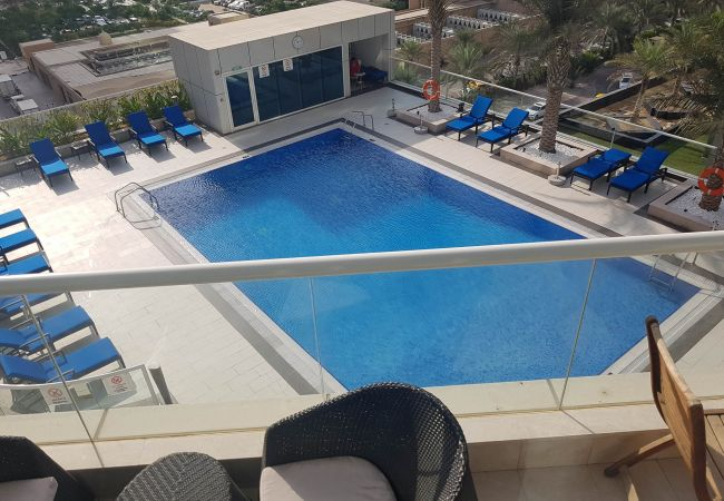 The balcony of this serviced apartment overlooks the swimming pool and lively JBR area